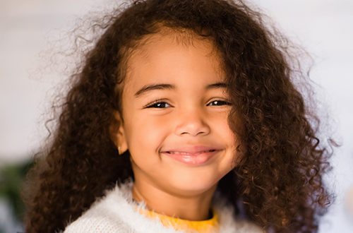 Cute afro girl at a Preschool & Childcare Serving Buffalo, NY