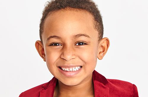 dark-skinned schoolboy at a Preschool & Childcare Serving Buffalo, NY